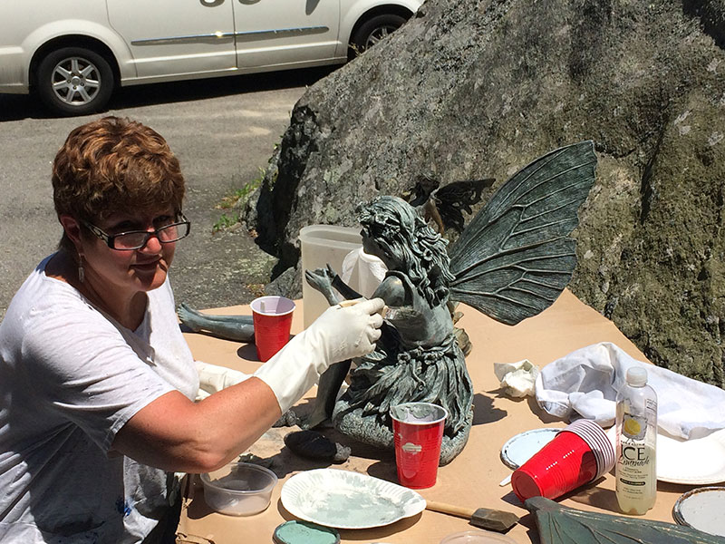 Debbie Farrand, interior designer at Dressing Rooms, restoring a sculpture.
